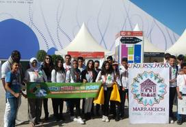 youth holding yvfp banner at COP22